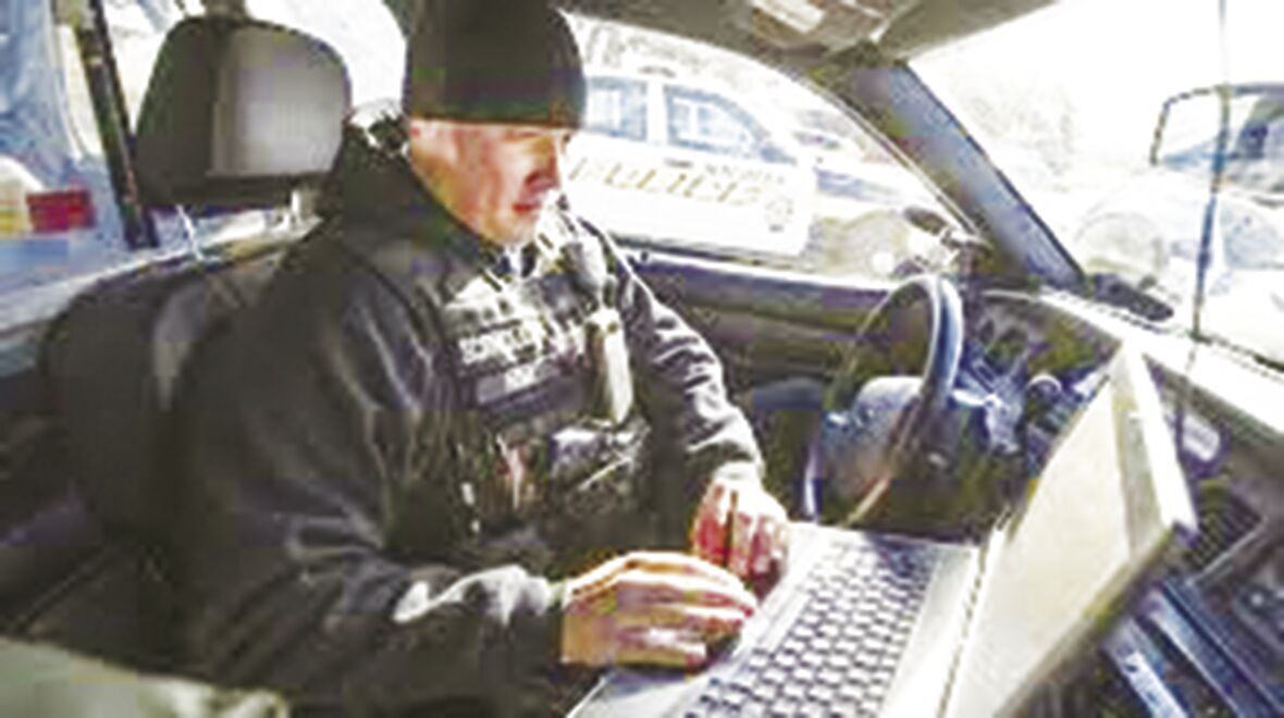 license plate readers police officer in car