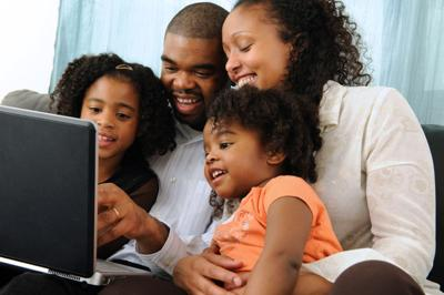 African American family time computer internet stock photo
