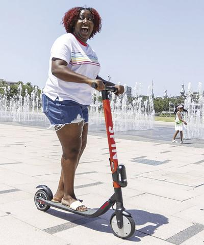Scooter woman fountains