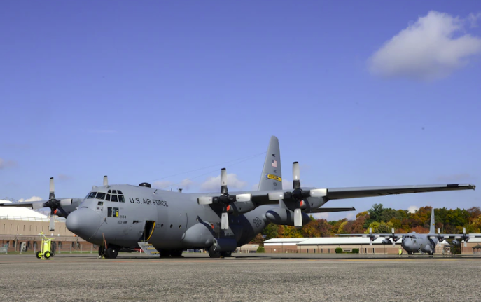 C-130 ON THE GROUND AT AIRPORT