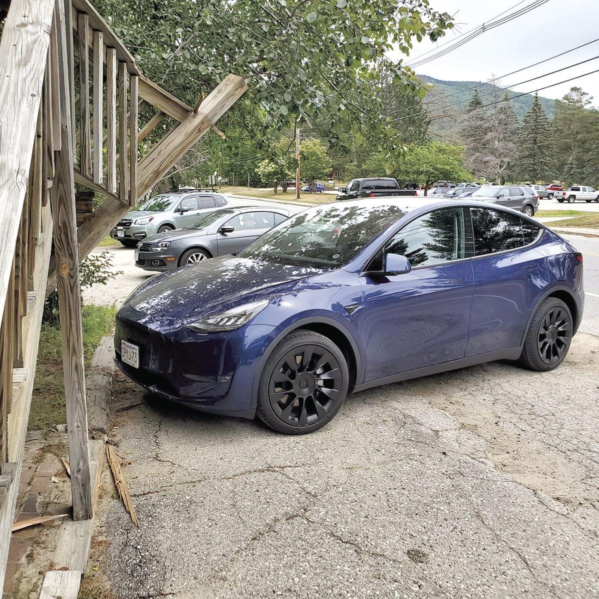 Tesla into J-Town Deli 3