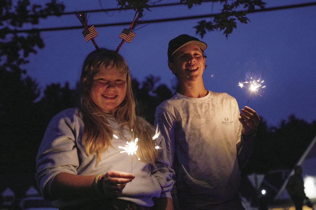 07-02-21 Jackson Fireworks kids with sparkler smiling