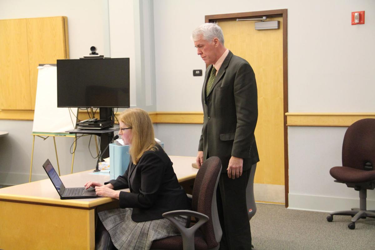 Judge hears motions in Woodburn case