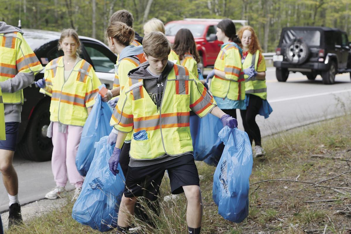 09-28-21 Trash Pick-Up walking through weeds