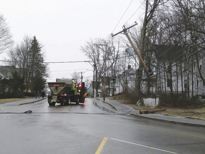 Plow truck hitting pole shuts down Washington Street