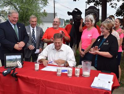 Governor signs N.H. Dairy premium bill