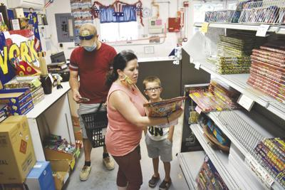 Family looks at fire works