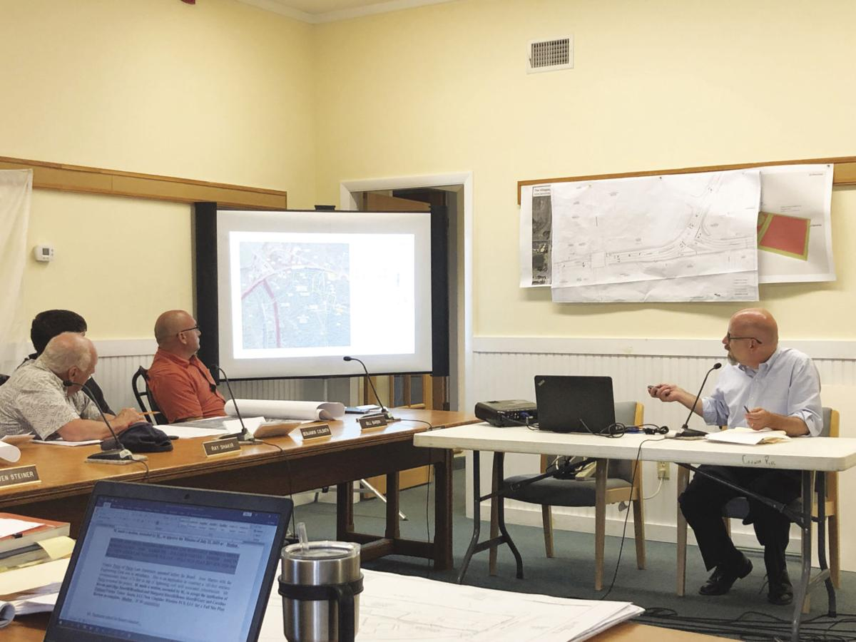 Planning board gives conditional OK for cell tower on