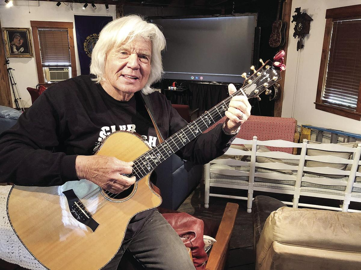 John Davidson with his guitar inside horizontal
