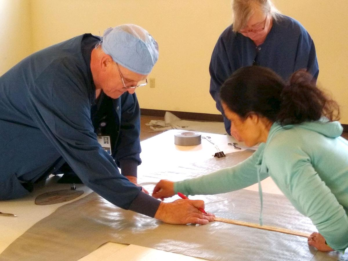 Memorial surgical staff making gowns