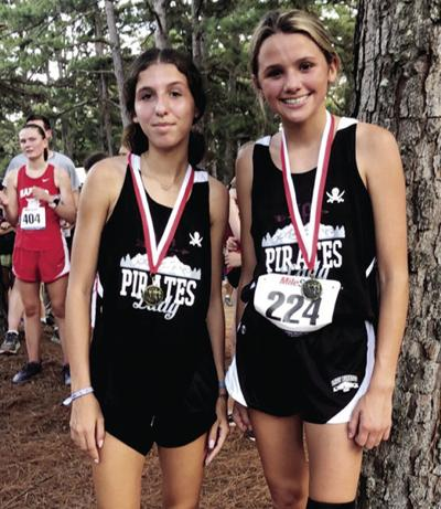 Pirates, Lady Pirates cross country teams compete at Heber Springs