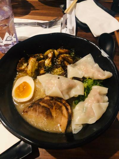 "Omaha's new ramen restaurant, JINYA Ramen Bar, at 7010 Dodge St. #106 offers a variety of Japanese dishes including the ""Sprouting Up Ramen"" dish with chicken wonton toppings."