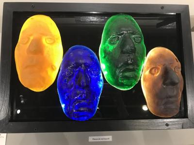 The re'flekSH(e)n art exhibit displays work from Frank Daharsh, Hope Dendinger and Dar Vande Voort that looks into how light can be reflected through glass-blown objects and paintings.
