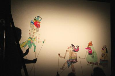 """Students in Creighton's Acting Styles class perform the Hindi tale of """"The Giant Who Chased the Moon"""" in the style of Indonesian shadow puppetry."""