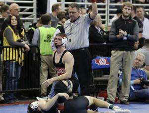 Zimmerer gets a takedown over Jarin Potts of Amherst in the state semifinals