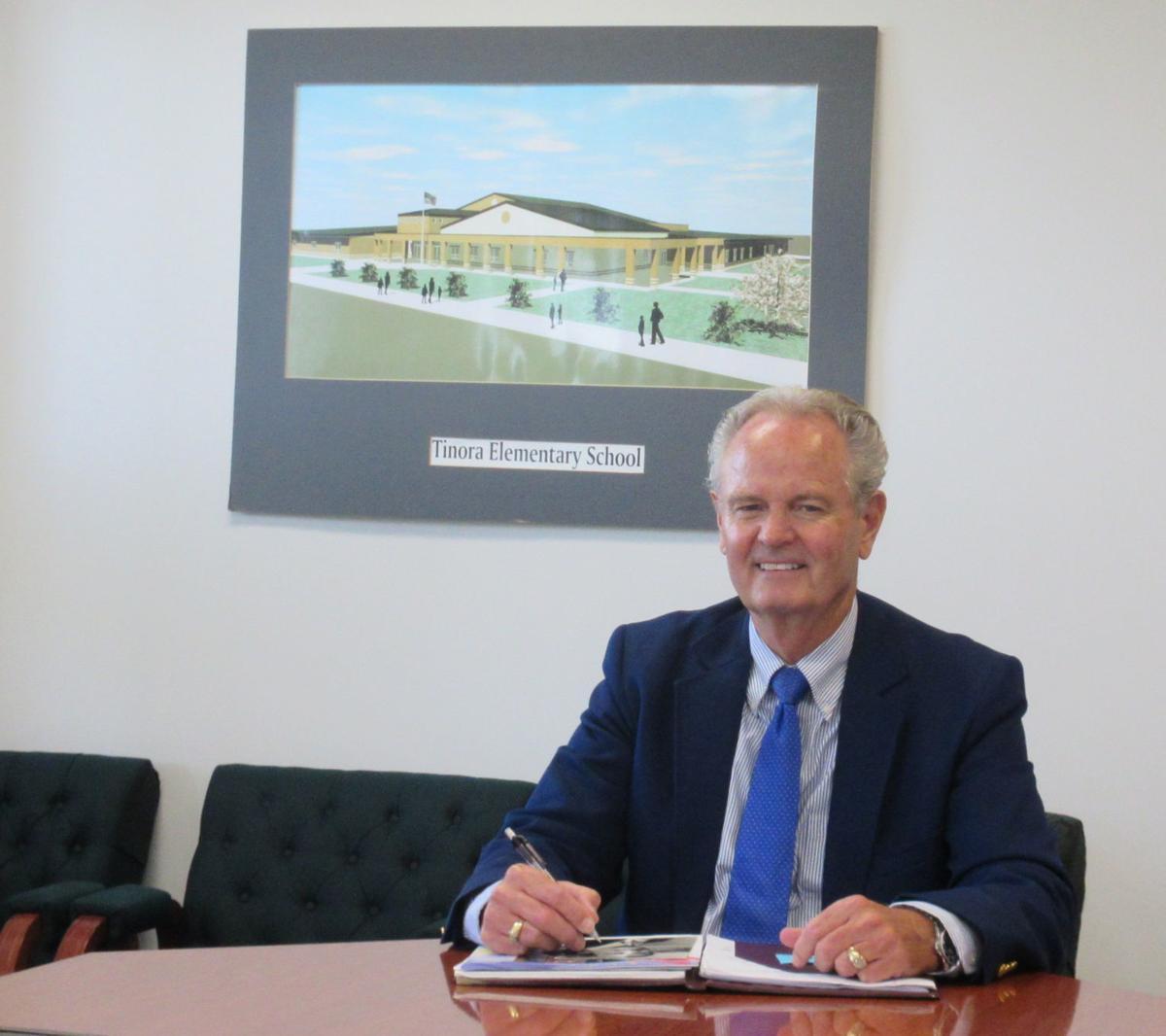 Jim Roach at desk