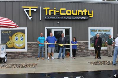 Taking Part In The Ribbon Cutting Ceremony For New Defiance Location Of Tri County Roofing And Home Improvement Are From Left A J Johnson