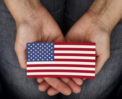 Old Glory in her hands