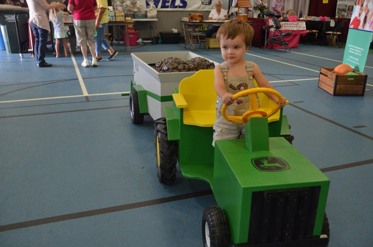 Zach on a tractor