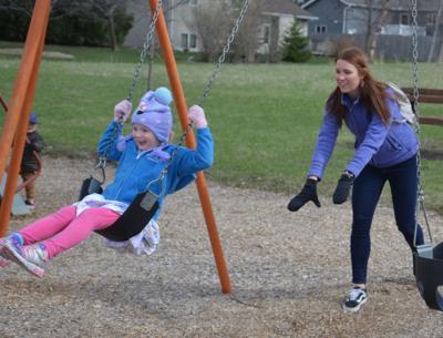 Stearns enjoys a push on the swings
