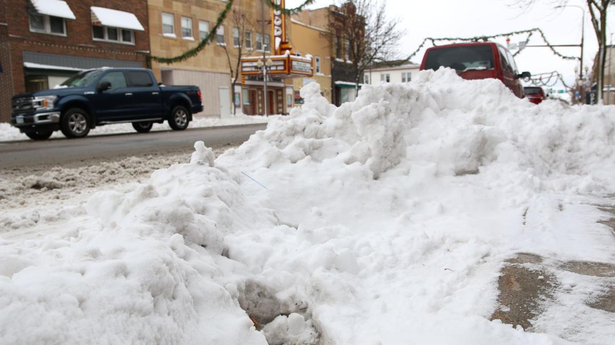 Snow plowed side road .JPG