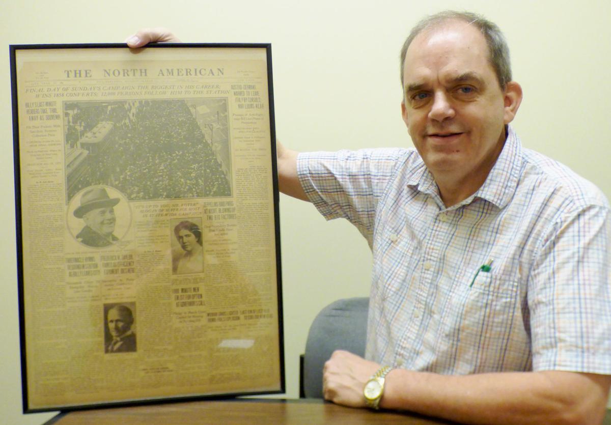 Craig Bishop with 1915 newspaper