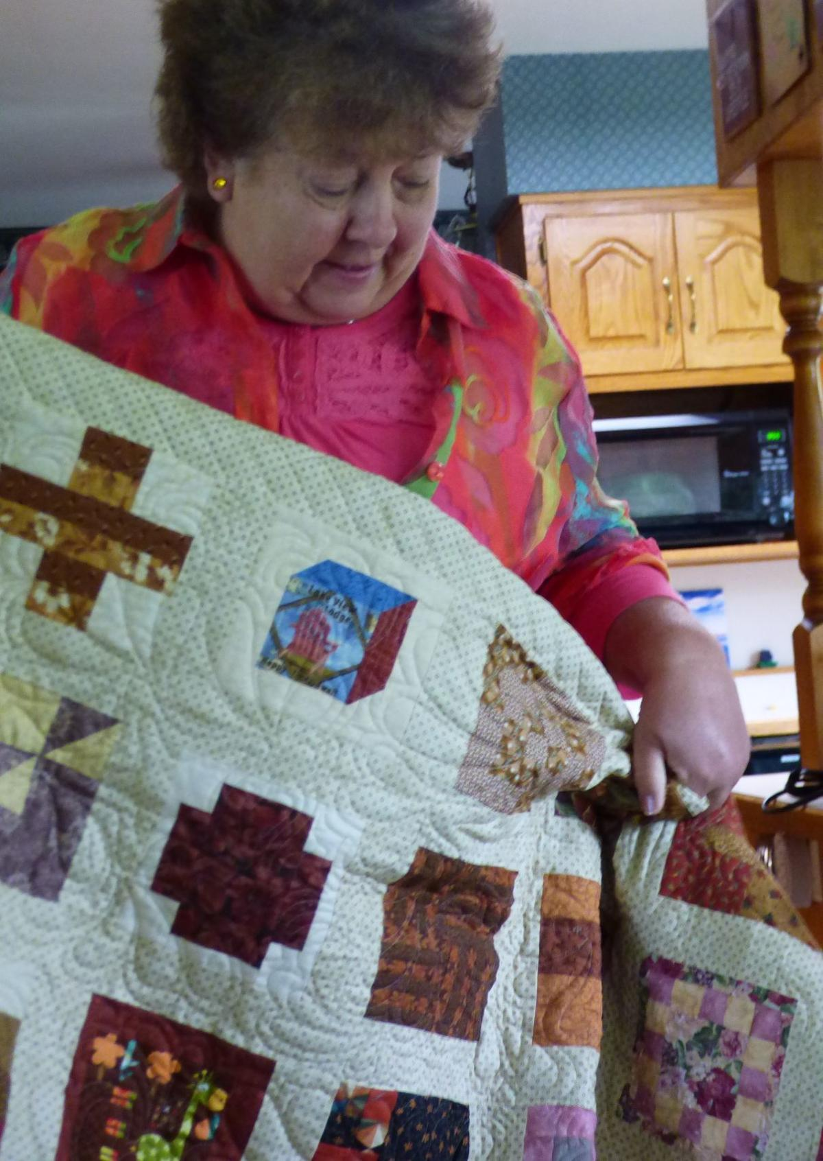 Evvie Hanson with quilt
