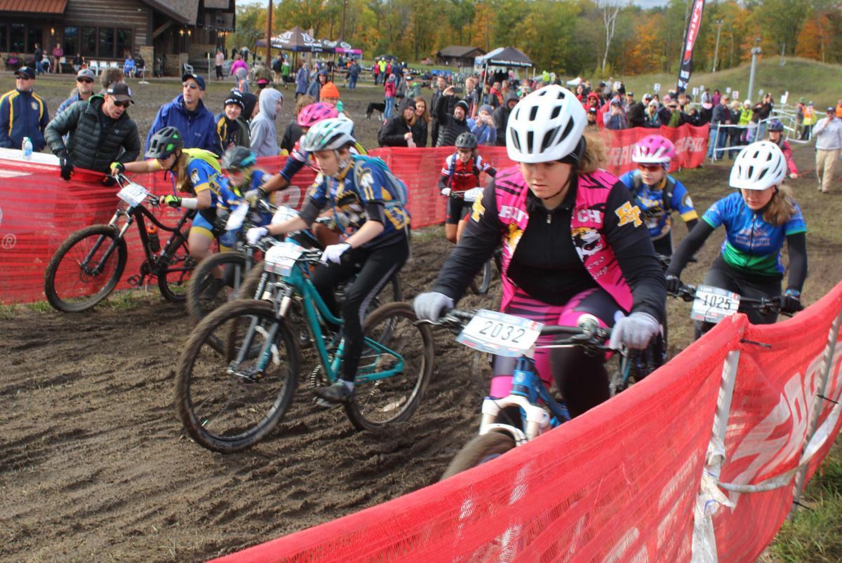 Moore bikes through mud