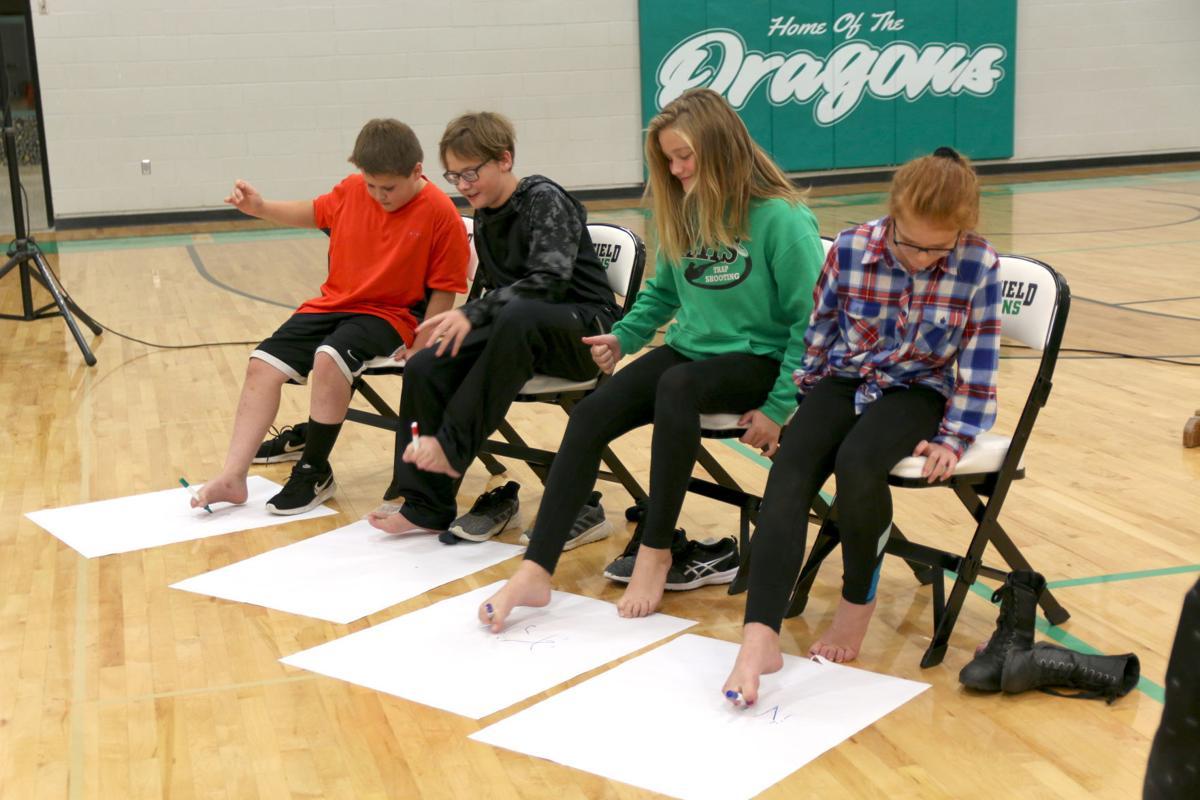 Volunteers writing with feet.JPG
