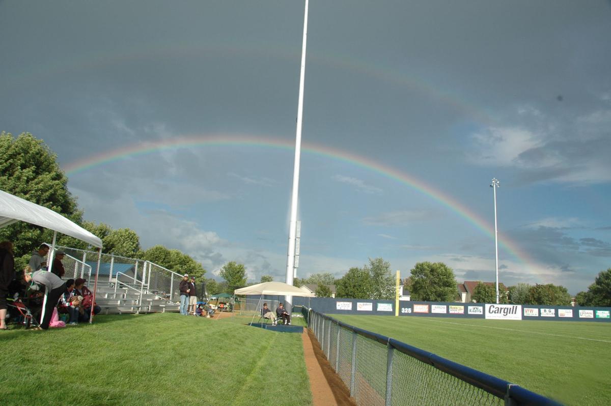 A rainbow forms over Optimist Park