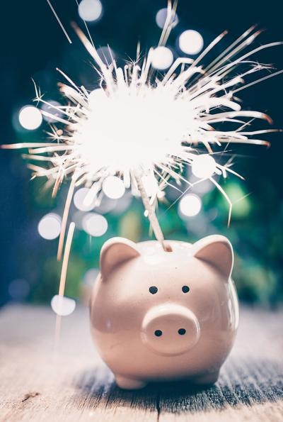 Piggy,Bank,With,Sparkling,Bengal,Flamer,On,Wooden,Table.,Christmas