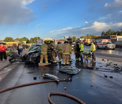 firefighters work a crash site