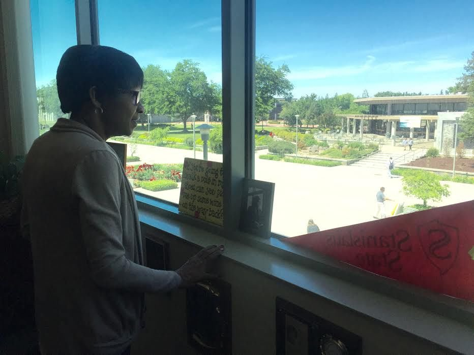 Wanda Bonnell looking outside her window