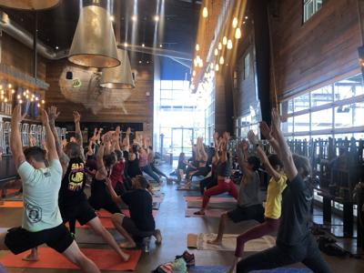 Warrior Yoga earns their glass at the Dust Bowl Brewery