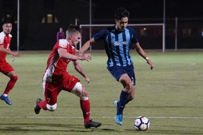 Men's Soccer Team trying to defend the ball from Sonoma State.