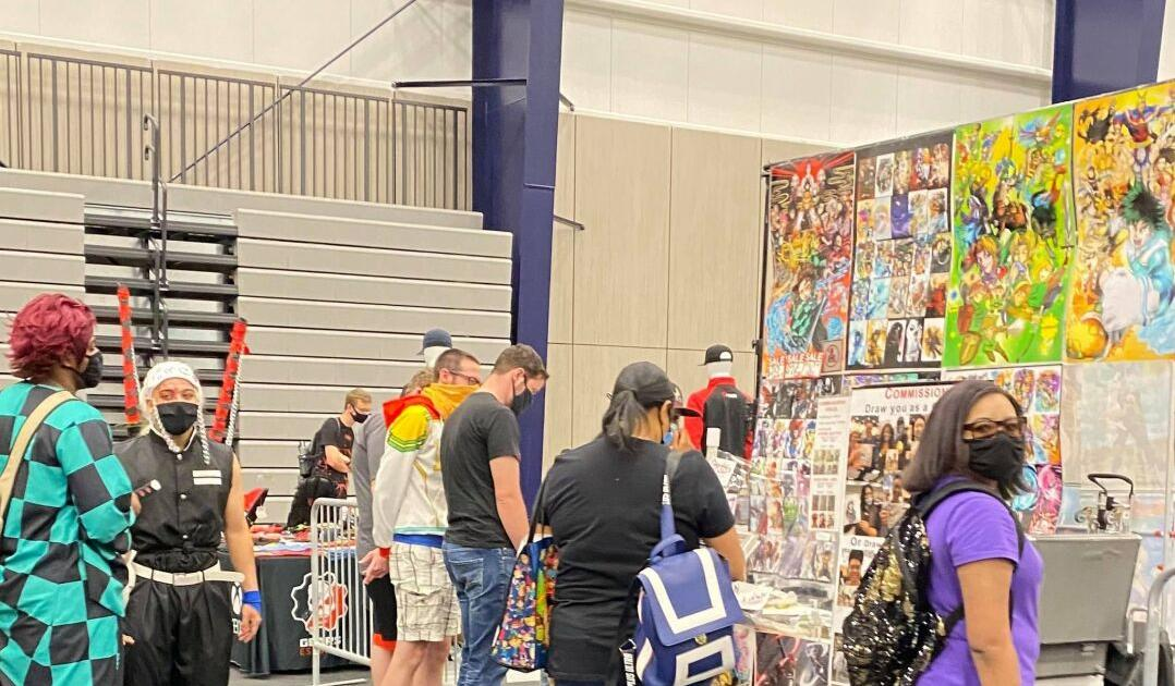 Attendees peruse a vendor booth at SacAnime
