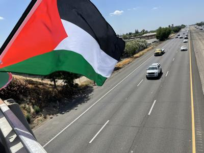 Palestinian Flag waving above overpass