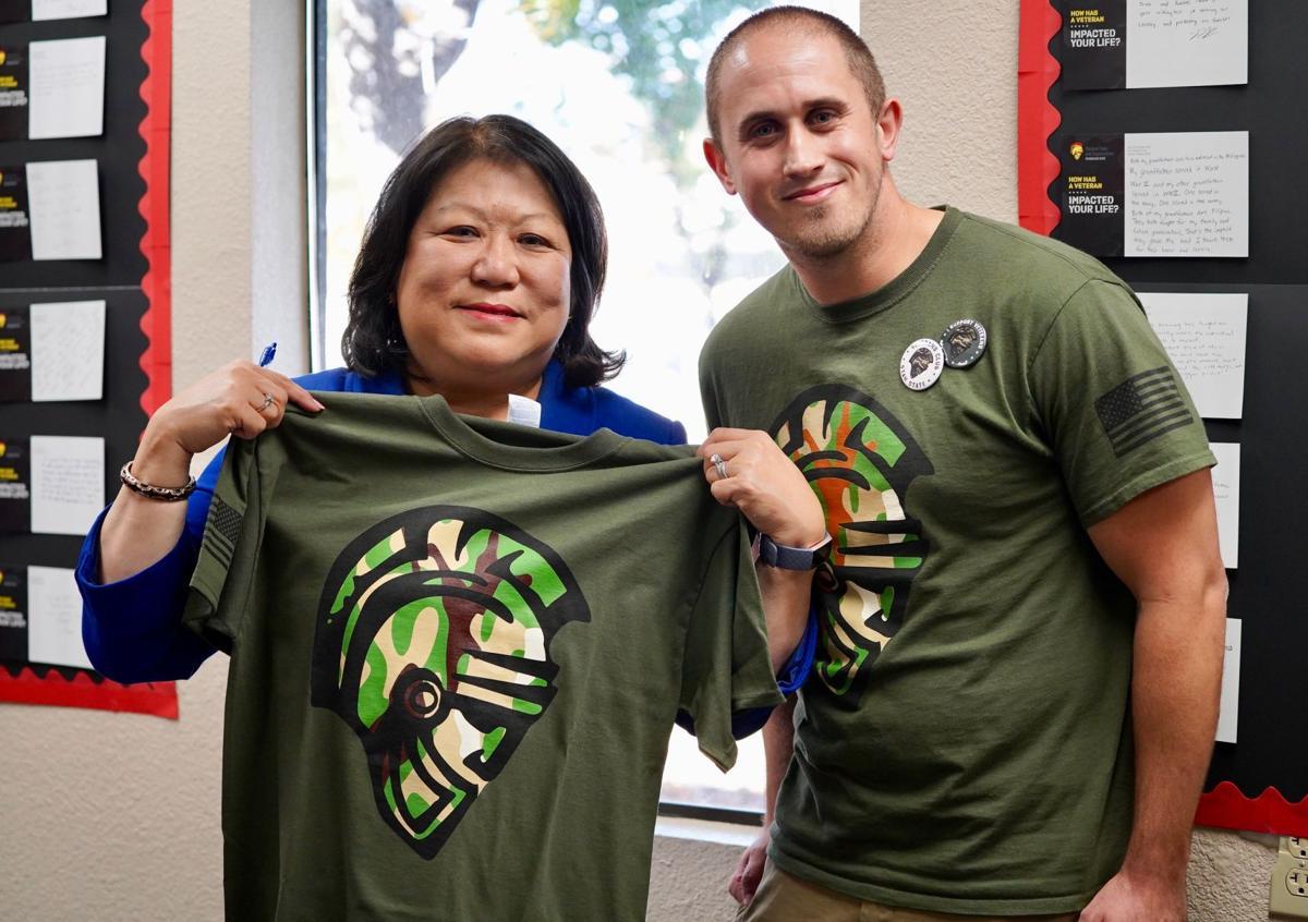 University President Ellen Junn supporting veterans at the Student Veteran Center.