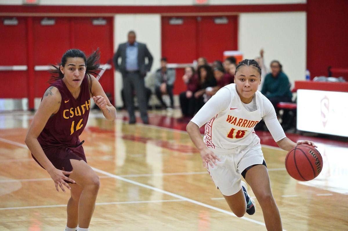 Guard Lauren Toler (sophomore, Child Development) dribbling the basketball