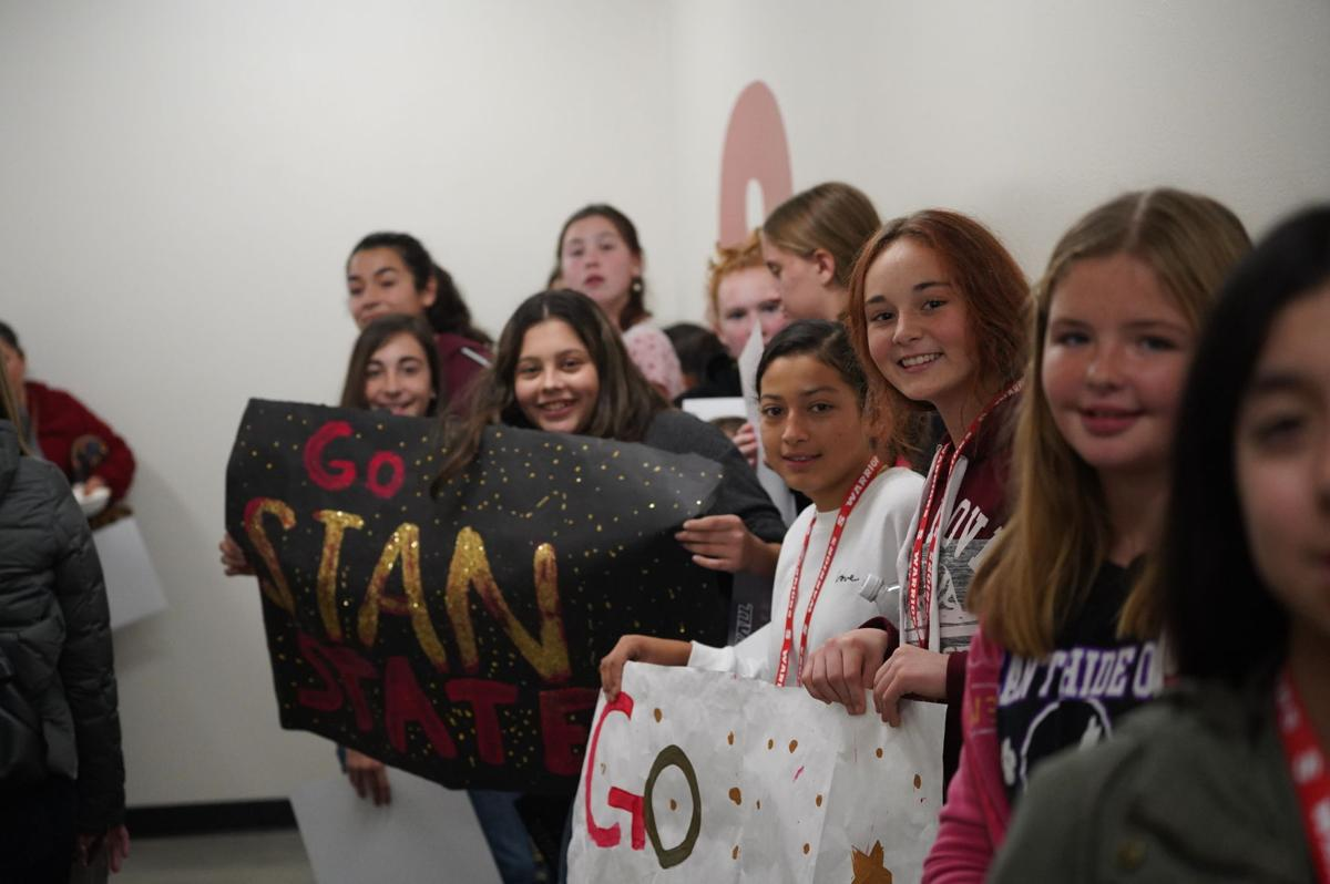 Denair middle school women's basketball team visiting and greeting the Stan State women's basketball team.
