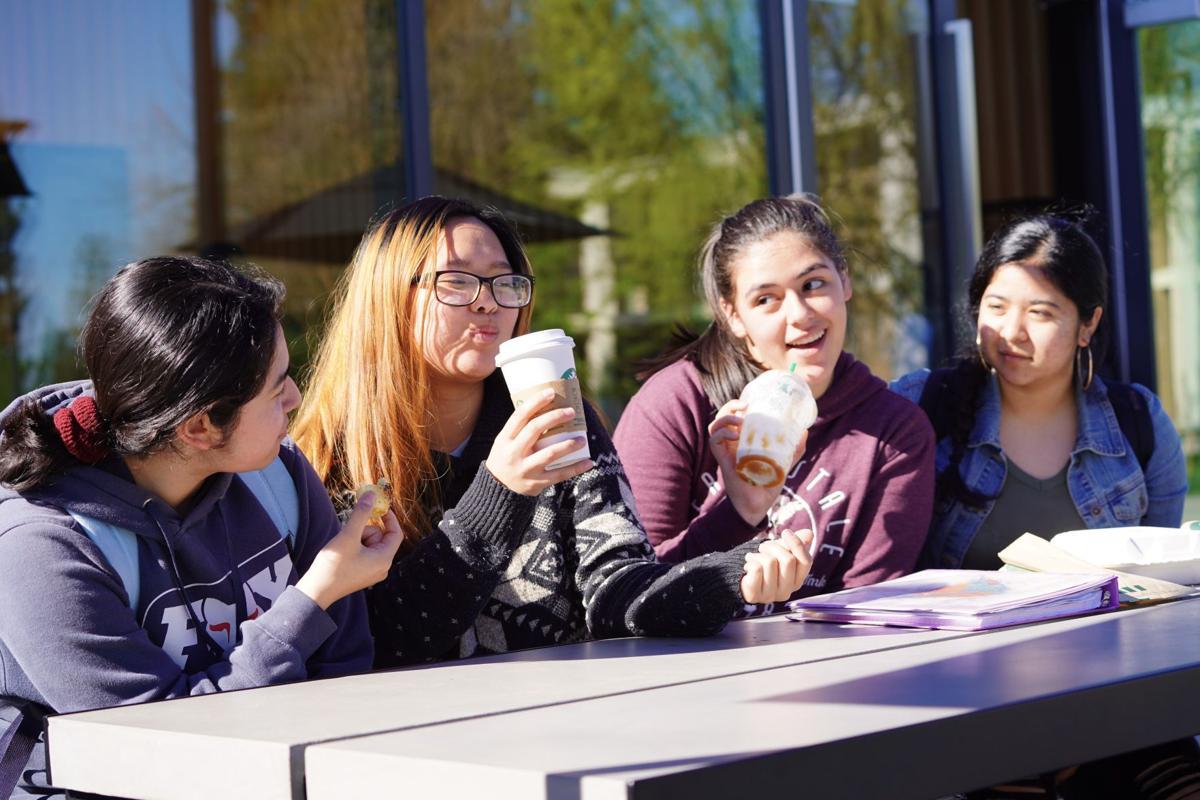 Students socializing near the Starbucks