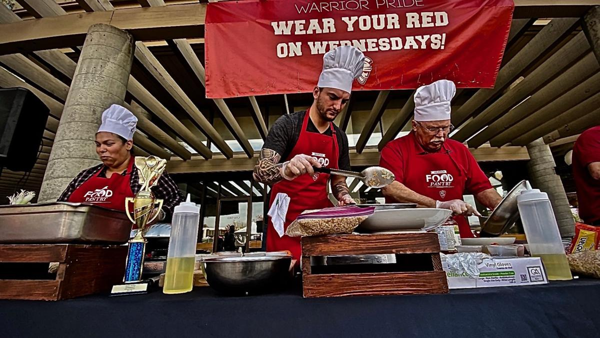 Competitors cooking dishes for the judges.