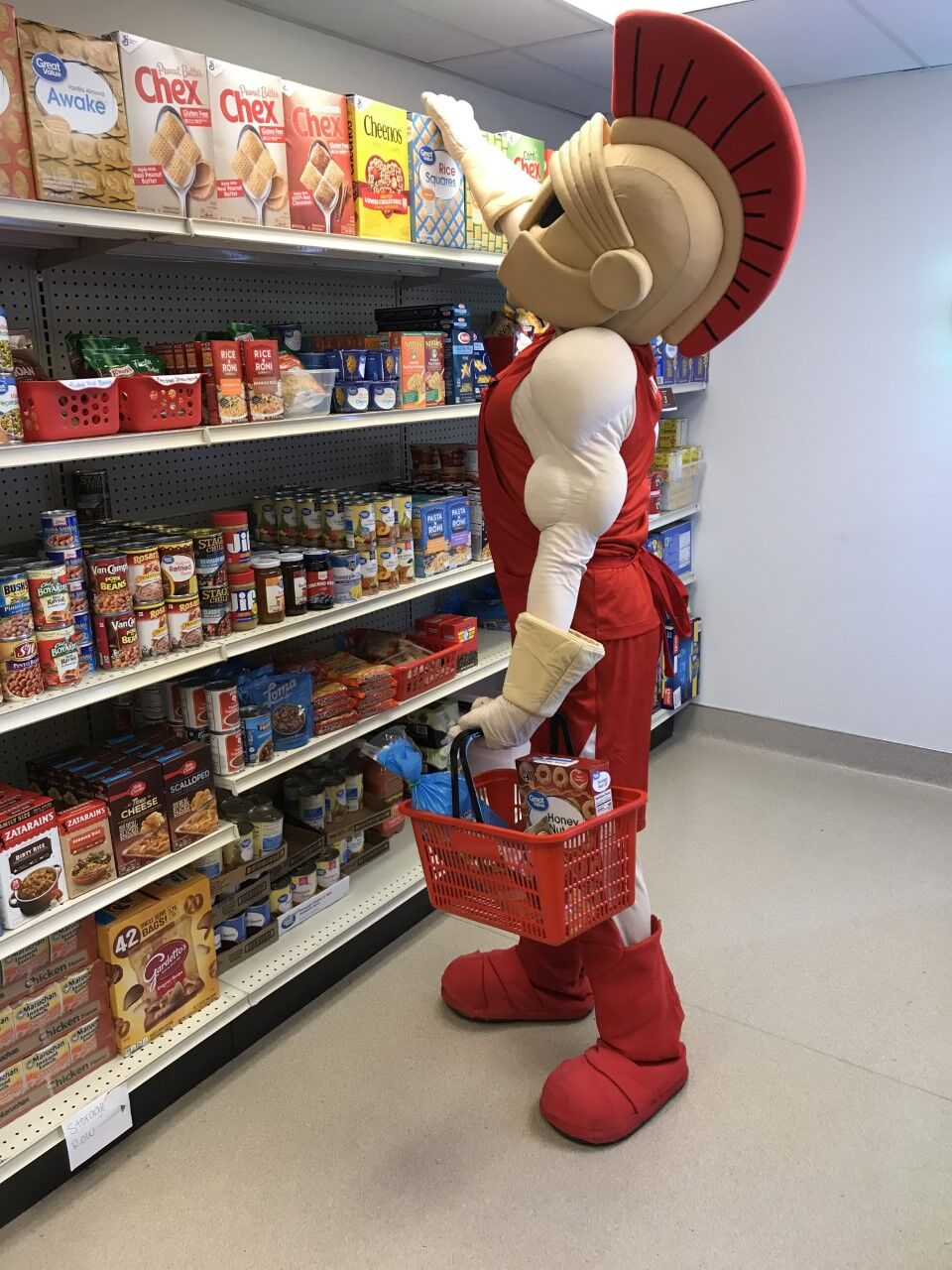 Titus the mascot in the food pantry