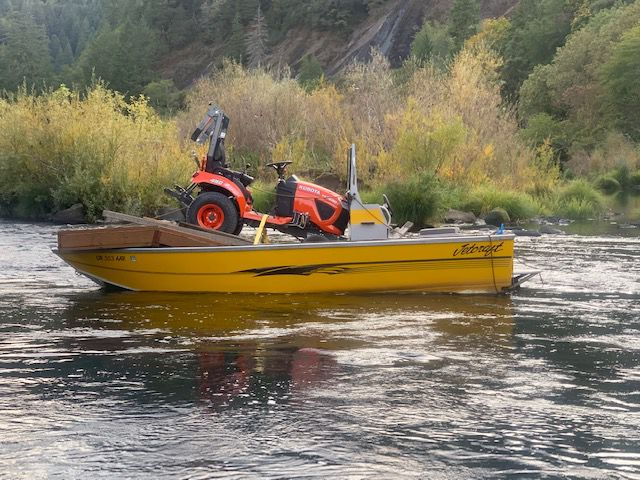 Tractor on Yellow Boat