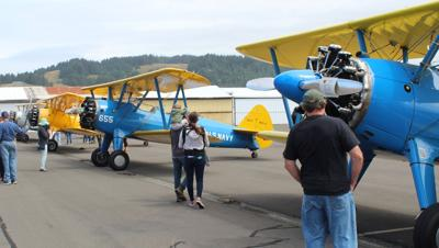 Vintage aircraft fly in to Gold Beach Airport
