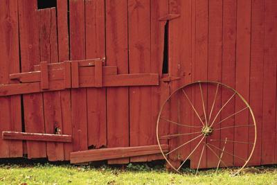 Red barn wall iron wheel May 2021