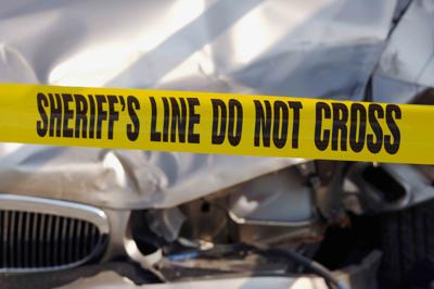 Sheriff caution tape car accident