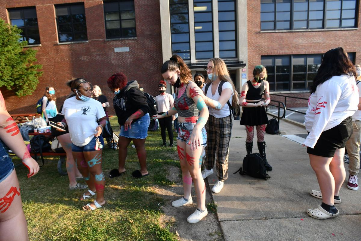 BBCHS students paint handprints in protest