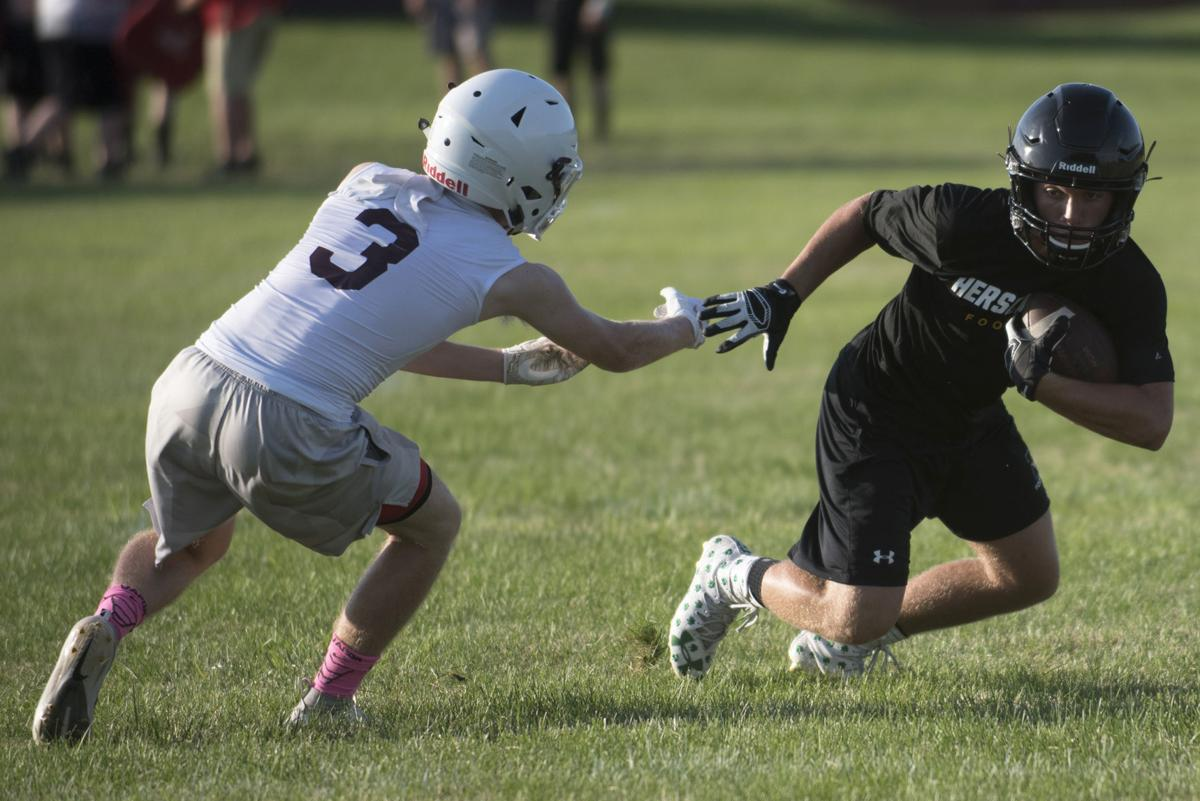 Football offseason heats up in summer sun