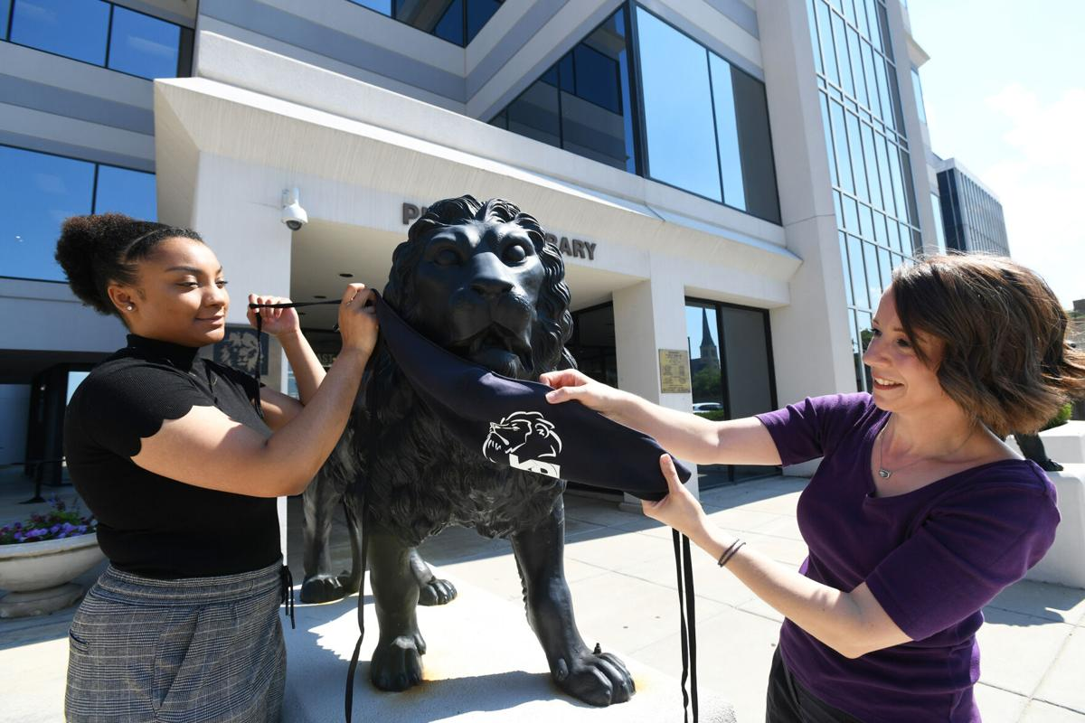 Library lions lose their masks
